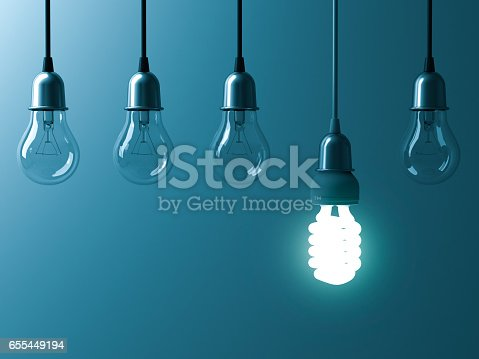 istock One hanging energy saving light bulb glowing different stand out from unlit incandescent bulbs with reflection on dark cyan background , leadership and different creative idea concept 3D rendering 655449194