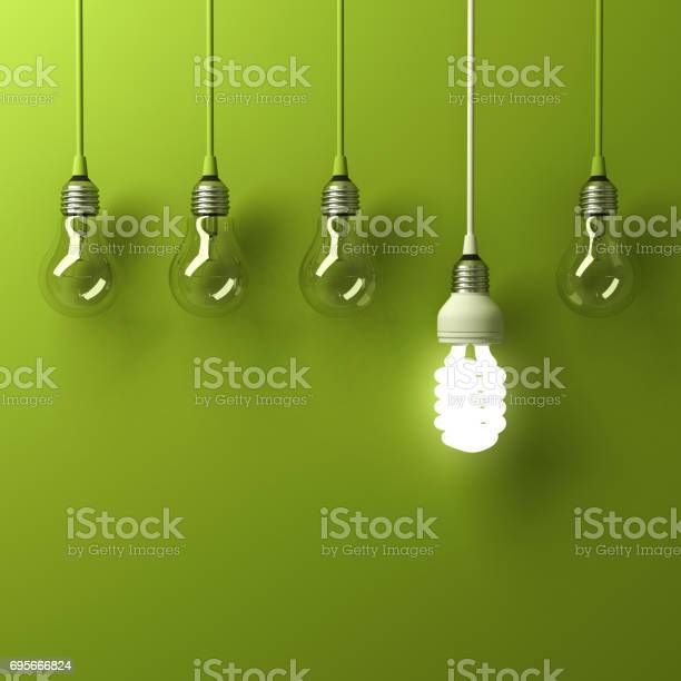 One hanging energy saving light bulb glowing different standing out picture id695666824?b=1&k=6&m=695666824&s=612x612&h=3r9z2kvd uxg50x9kqnwve41ium2jagntttktybmyjo=