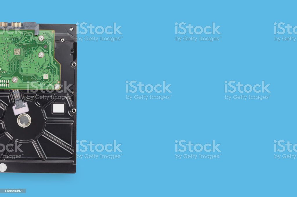 One hard disk drive with circuit for computer on blue table. Top...