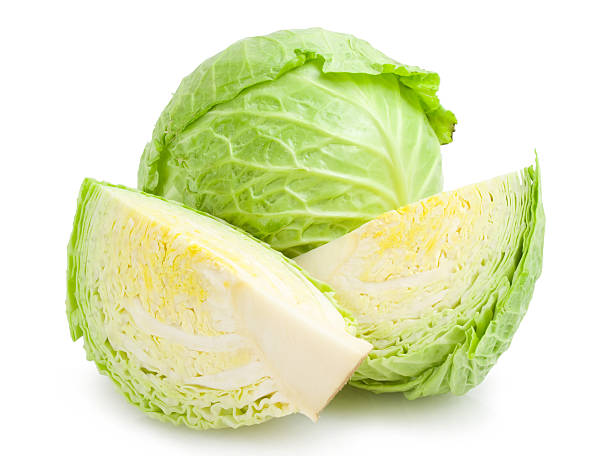 one head of lettuce cut in half with another whole head  - 椰菜 個照片及圖片檔