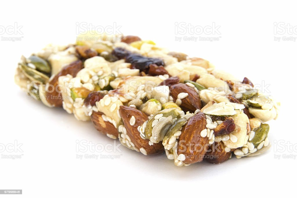 One healthy granola bar on white royalty-free stock photo