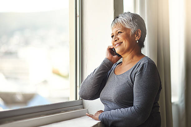 one hello can make someone's day - older woman phone stock photos and pictures