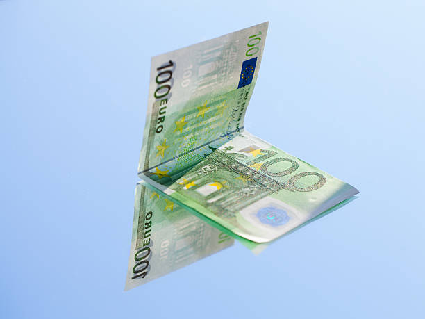 One houndred-euro banknote on blue background stock photo