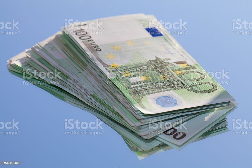 One houndred-euro banknotes on blue background stock photo
