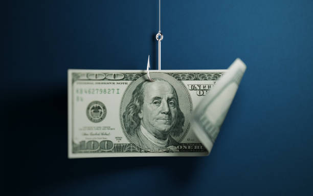 One Hundred American Dollar Banknote And A Fishing Tackle On Blue Background - foto stock