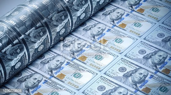 One hundred American dollars being printed. Selective focus. Horizontal composition with copy space. Money printing concept.