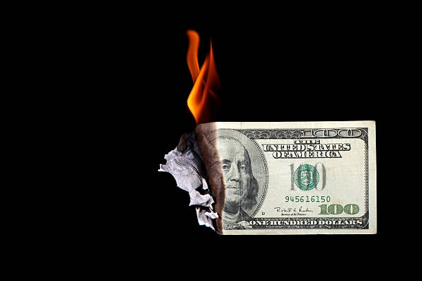 One hundred dollar bill burning  money to burn stock pictures, royalty-free photos & images