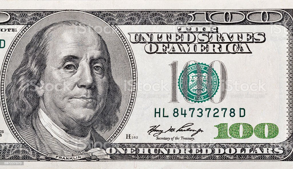 One hundred dollar bill fragment closeup stock photo