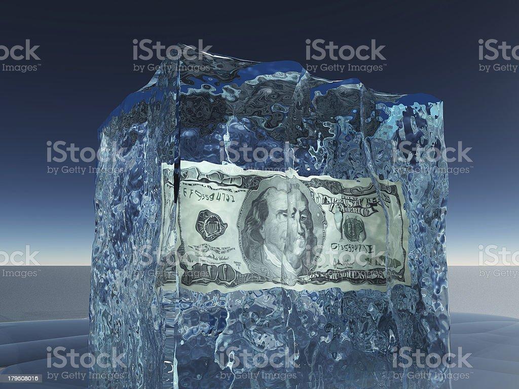 One hundred dollar bill frozen in ice stock photo