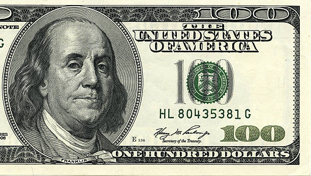 One hundred dollar bill macro shot. One hundred dollar bill macro shot. Benjamin Franklin as depicted on the bill. benjamin franklin stock pictures, royalty-free photos & images