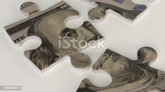 istock A one hundred dollar bill puzzle 1056380414