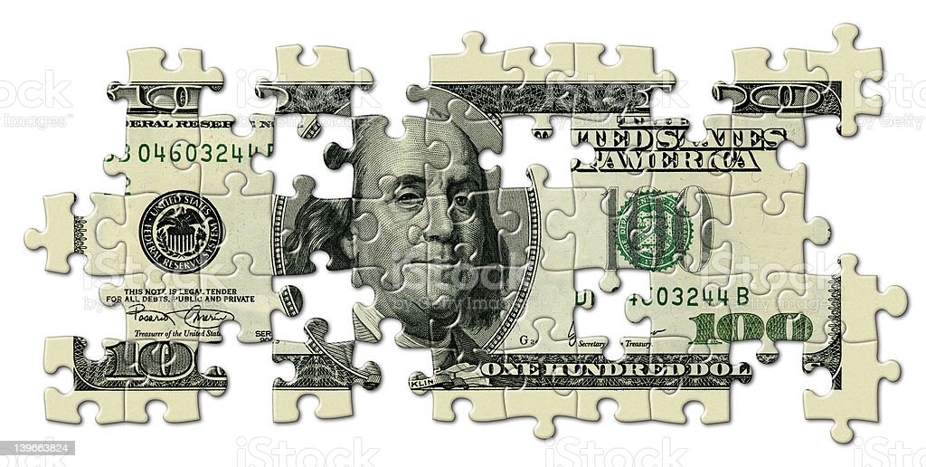 One Hundred Dollar Bill Puzzle with Missing Pieces stock photo