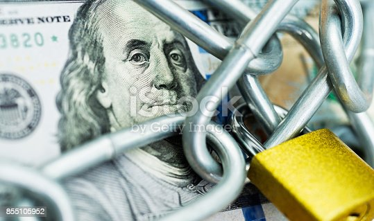 istock One hundred dollar bill with a chain and lock 855105952