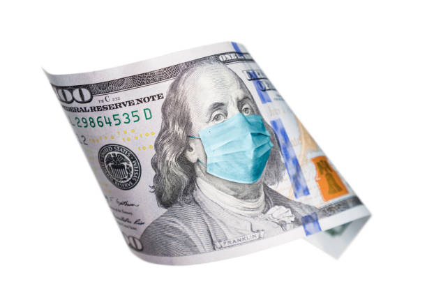 One Hundred Dollar Bill With Medical Face Mask on Benjamin Franklin Isolated on White stock photo