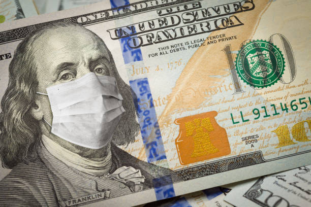 One Hundred Dollar Bill With Medical Face Mask on George Washington stock photo