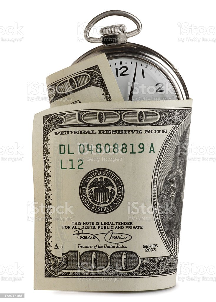 One hundred dollar bill wrapped around pocket watch royalty-free stock photo