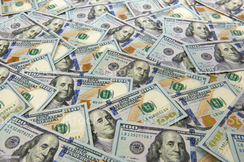 One Hundred Dollar Bills As A Wallpaper Stock Photo