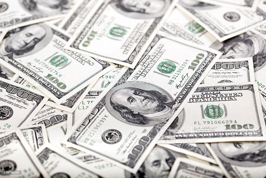 One Hundred Dollar Bills Background - Mess stock photo
