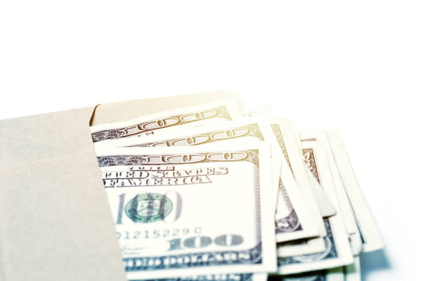 One Hundred Dollar Bills Cash in Brown Envelop Close-up of one hundred dollar bills cash in brown envelope. allowance stock pictures, royalty-free photos & images