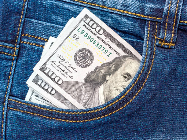 one hundred dollar bills in front pocket of jeans. - pocket stock photos and pictures