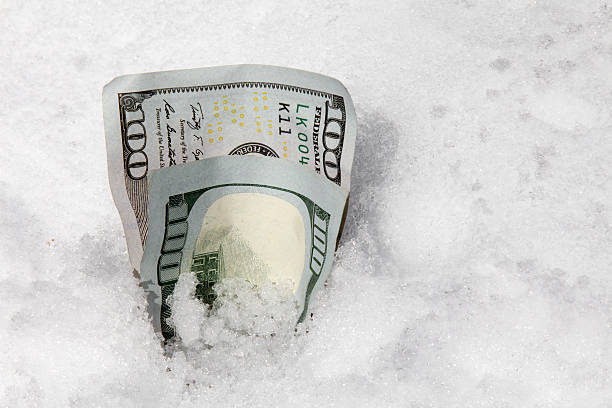 One hundred dollar bills in the snow