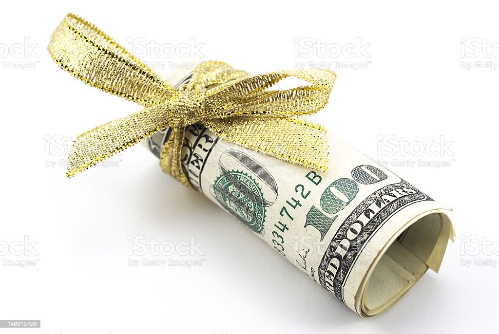 One hundred dollar bills with gold ribbon One hundred dollar bills with gold ribbon, the best present Incentive Stock Photo