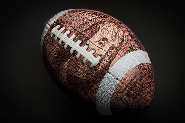 One hundred dollar football stock photo