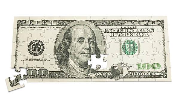 One Hundred dollar puzzle stock photo