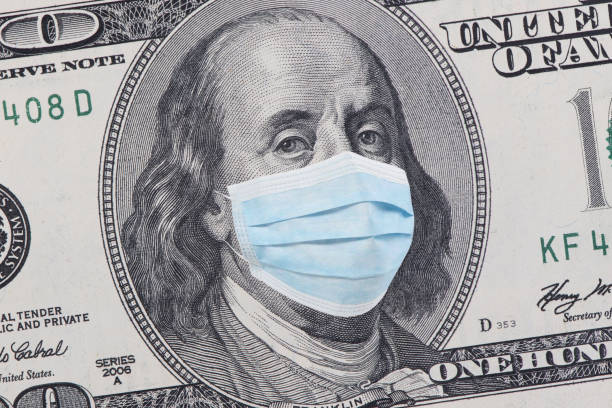 One hundred dollars banknote One hundred dollars banknote with facemask. American cash money. Financial crisis and coronavirus pandemic concept. COVID-19 coronavirus in USA. benjamin franklin stock pictures, royalty-free photos & images