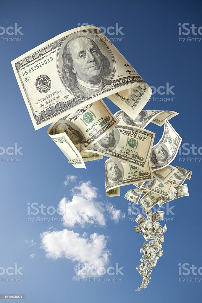 One Hundred Dollars Bill falling in the clouds royalty-free stock photo