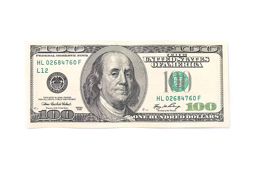 One hundred dollars isolated on white background. Top view.