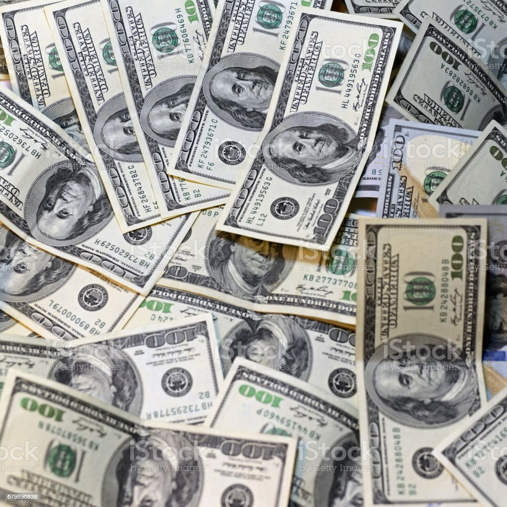 One hundred dollars pile as background. stock photo
