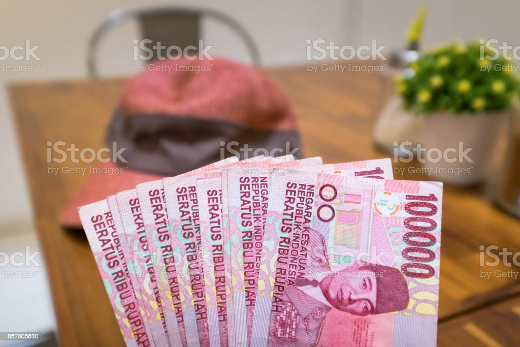 One Hundred Thousand Rupiah Banknotes money in coffee shop, Indonesia stock photo