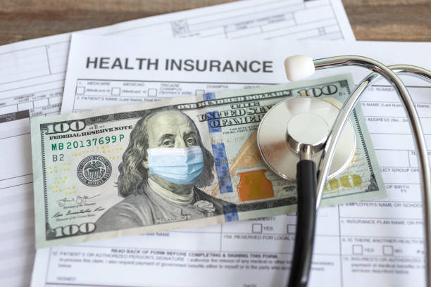 One hundred us dollar with face mask on insurance paper bill. Health care cost during coronavirus covid outbreak concept One hundred us dollar with face mask on insurance paper bill. Health care cost during coronavirus covid outbreak concept expense stock pictures, royalty-free photos & images