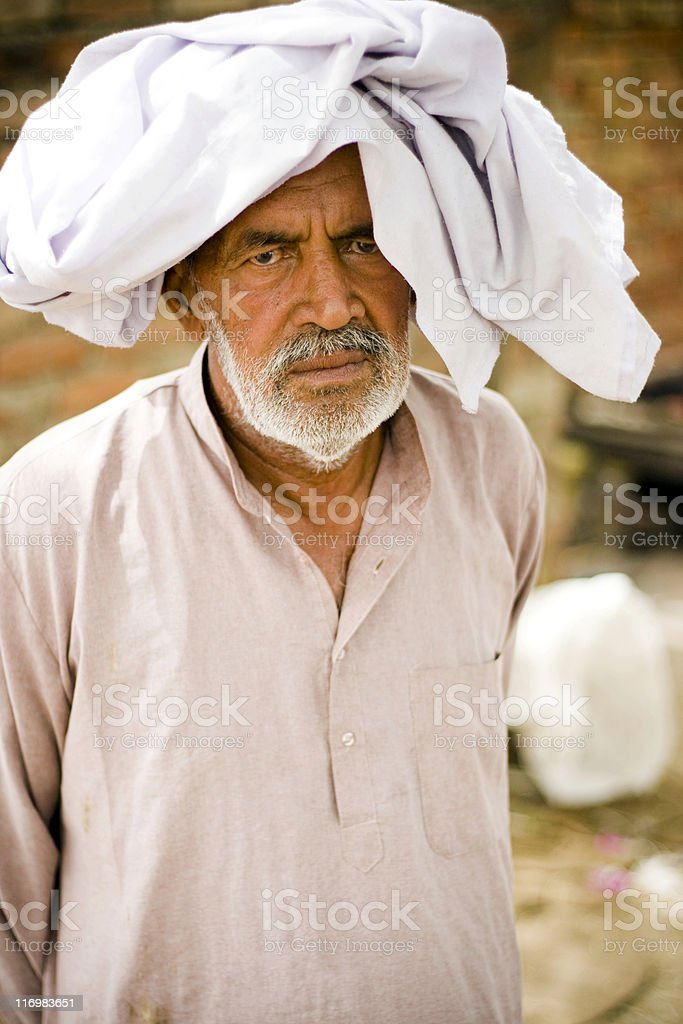One Indian Senior male in Summer covering his head royalty-free stock photo