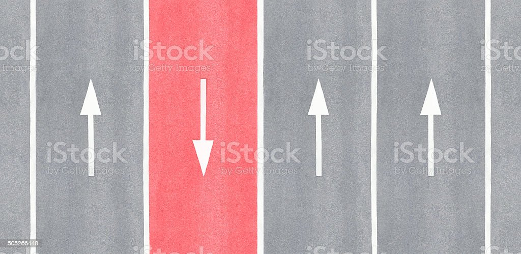 One is against. Arrow reversed against the others. stock photo