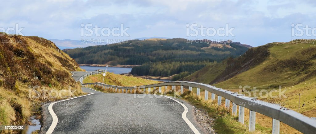 One Lane Road Winds Through Scotland Countryside stock photo