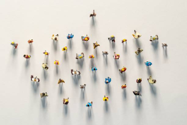 one leader. A group of people follows. a lot of followers. Concept of Business competition and Leadership stock photo