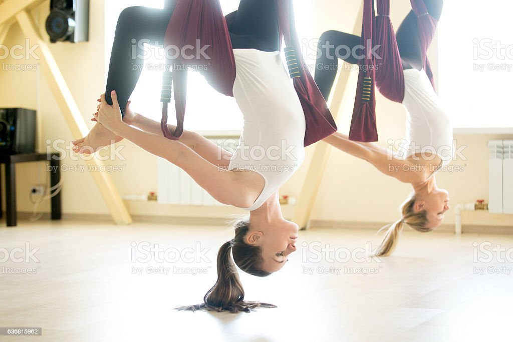 One legged chakrasana pose in hammock stock photo
