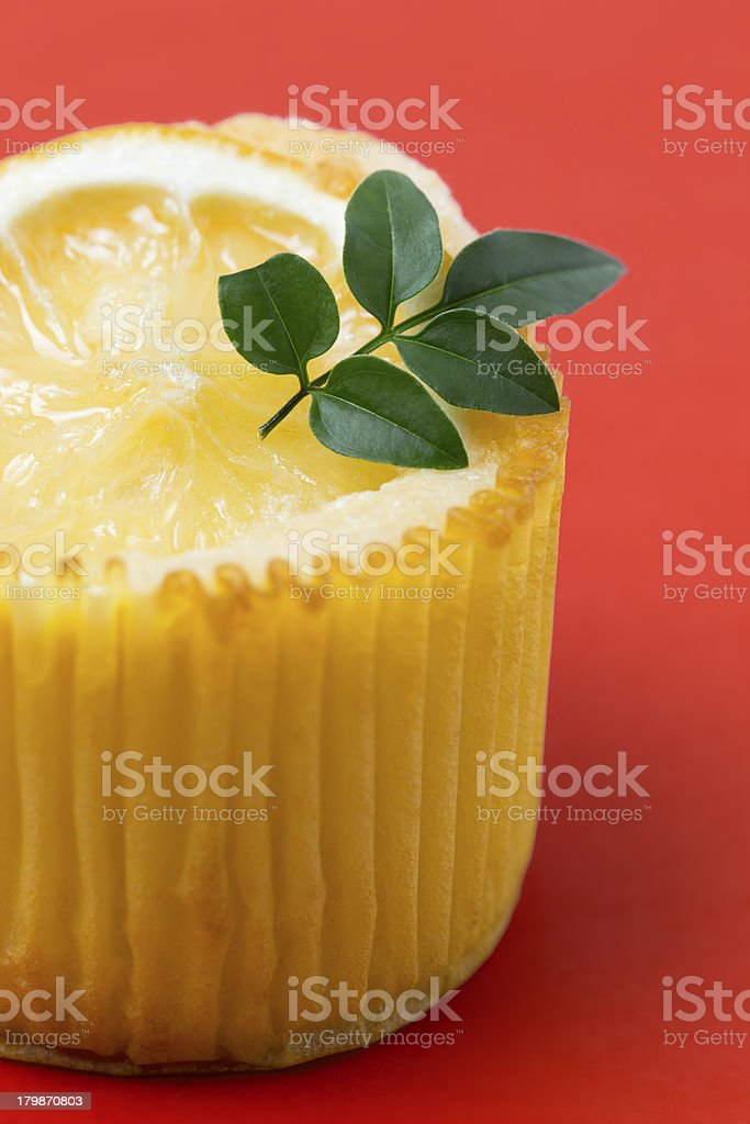 One lemon muffin on red background stock photo