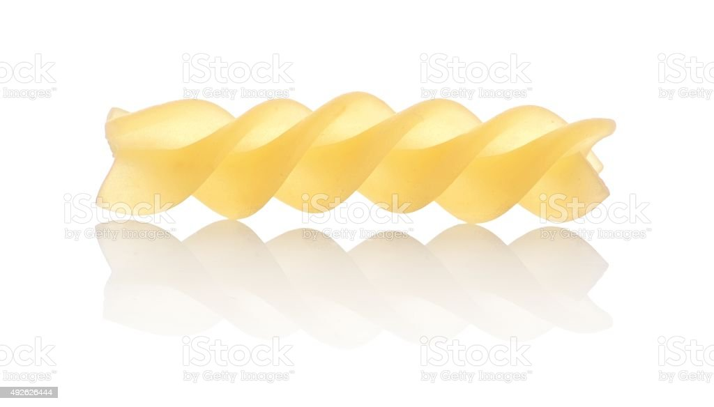 One macro shot of fusilli pasta isolated on white stock photo