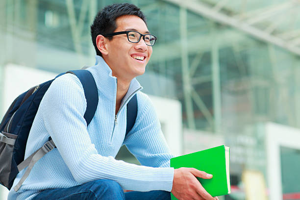 one male college student in campus stock photo