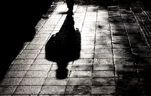 One man alone in the dark shadow silhouette