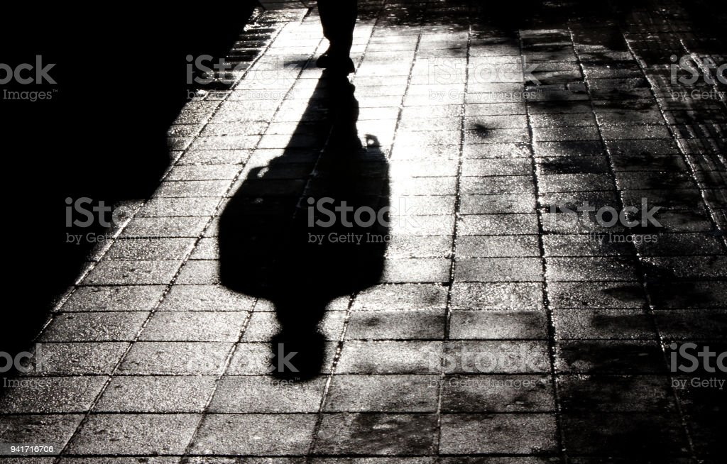 One man alone in the dark shadow silhouette stock photo