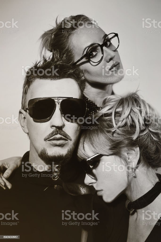 One man and two women stock photo