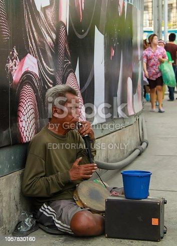 istock Bangkok - 2010: One man band busker along the streets of Bangkok 1057830160