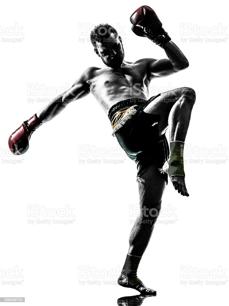 one man exercising thai boxing silhouette stock photo