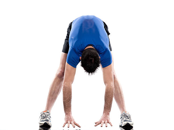 one man exercising workout fitness Exercises stretching workout posture by a man  in studio    on white backgroundPlease see some pictures from my lightboxes : touching toes stock pictures, royalty-free photos & images