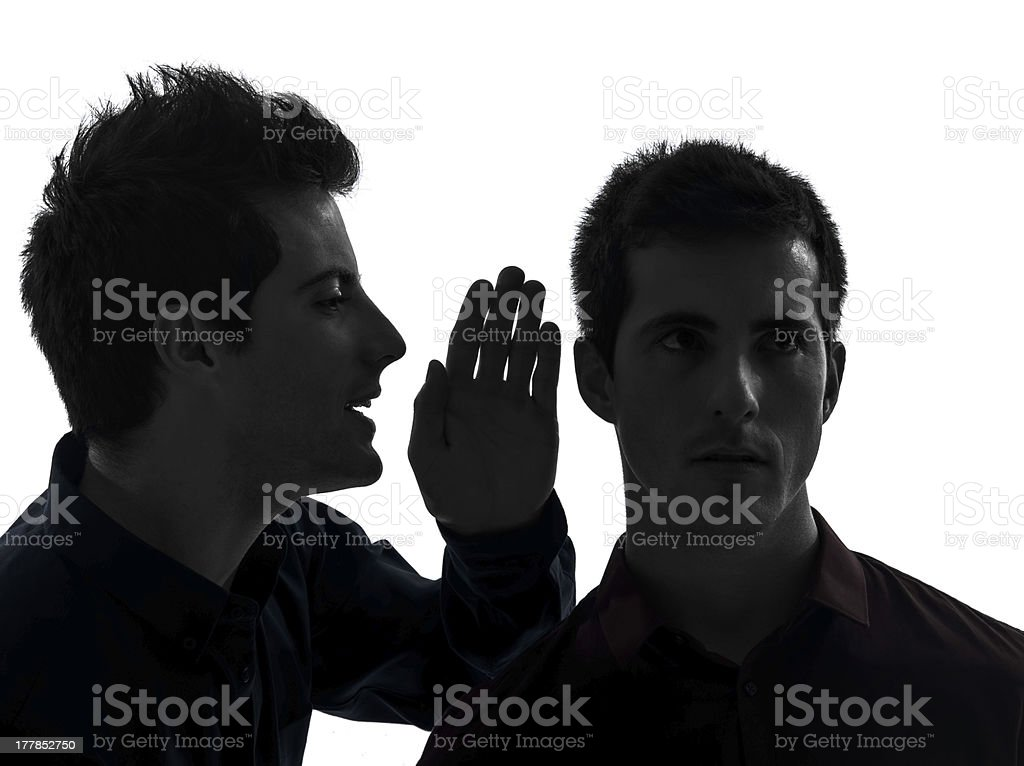 one man hearing voices gossip royalty-free stock photo