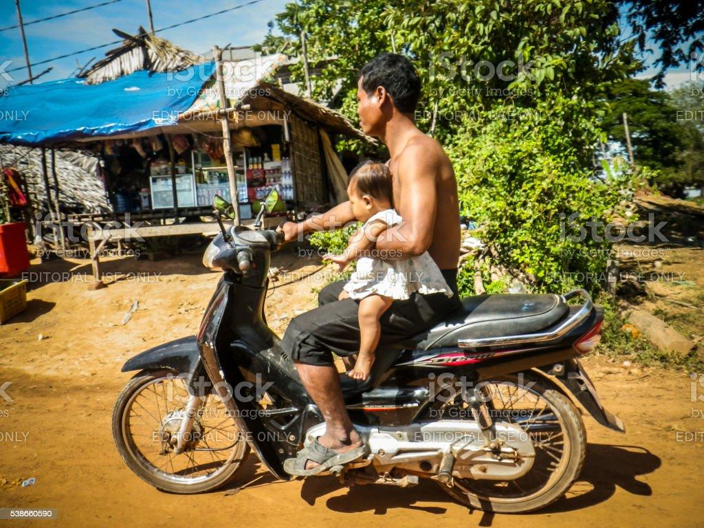 E Man Holding Baby Driving Moped Koh Lanta Thailand Stock